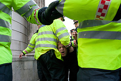 © licensed to London News Pictures. London, UK 12/05/2012. An Occupy London protester being carried by the City of London police forces as the protesters occupy the area outside the Bank of England, this evening (12/05/12). Photo credit: Tolga Akmen/LNP