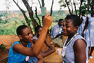 Doris in Ghana gets a stamp after she votes in the World's Children's Prize Global Vote. The stamp prevents election fraud!