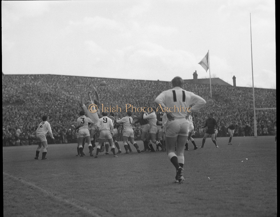 Ireland Vs England at Lansdowne Rd..1971..13.02.1971..02.13.1971..13th February 1971..In the Five Nations Championship, Ireland took on England at Lansdowne Road,Dublin. The final score in the game was Ireland 6,England 9..Bob Hiller,the England fullback,scored all his teams points with three penalties..Ireland replied with two tries from Grant and Duggan..In the championship,Wales won the Triple Crown and completed the Grand Slam when they defeated France in their final game of the season..Image of the backdrop of a packed terrace as both sides struggle for control of the ball.