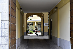 Milan, Approach to Phase 2 of the Coronavirus Emergency, People on the Naviglio Grande, Darsena and Piazza 24 Maggio, in the photo woman trains in the courtyard of her home