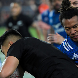 France's Teddy Thomas tackles NZ's Rieko Ioane during the Steinlager Series international rugby match between teh New Zealand All Blacks and France at Eden Park in Auckland, New Zealand on Saturday, 9 June 2018. Photo: Dave Lintott / lintottphoto.co.nz