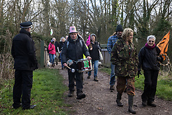 Uxbridge, UK. 1 February, 2020. Police officers observe environmental activists from Stop HS2, Save the Colne Valley and Extinction Rebellion campaigning against the controversial HS2 high-speed rail link on a 'Still Standing for the Trees' march from the Harvil Road wildlife protection camp in Harefield through Denham Country Park to three addresses closely linked to Boris Johnson in his Uxbridge constituency. The Prime Minister is expected to make a decision imminently as to whether to proceed with the high-speed rail line.