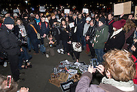 A few hundred people gathered in Trafalgar square following the killings at Charlie Hebdo - a French satirical weekly - offices earlier in the day in Paris. People posed with pens and #jesuisCharlie signs.