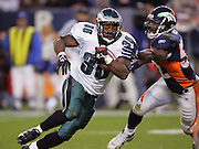 DENVER - OCTOBER 30:  Running back Brian Westbrook #36 of the Philadelphia Eagles runs the ball and avoids a tackle by linebacker Ian Gold #52 of the Denver Broncos on October 30, 2005 at INVESCO Field at Mile High in Denver, Colorado. The Broncos defeated the Eagles 49-21. ©Paul Anthony Spinelli *** Local Caption *** Brian Westbrook;Ian Gold