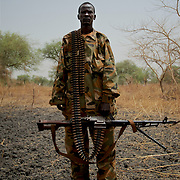 An SPLA soldier stands for a portrait at the frontline in South Sudan's Bentiu region during the conflict with the neighbouring Sudan over the control of oil fields in a disputed border area.