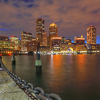 Boston skyline photography from New England Photography Guild member and award winning fine art photographer Juergen Roth showing Boston Financial Waterfront District landmarks such as One International Place, Boston Harbor Hotel, Independence Wharf, Department of Homeland Security building, and other structures along Rowes Wharf photographed on a beautiful winter night. <br />