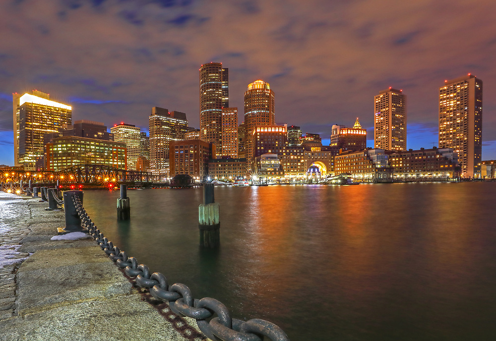 Boston skyline photography from New England Photography Guild member and award winning fine art photographer Juergen Roth showing Boston Financial Waterfront District landmarks such as One International Place, Boston Harbor Hotel, Independence Wharf, Department of Homeland Security building, and other structures along Rowes Wharf photographed on a beautiful winter night. <br /> <br /> Skyline photo images of Boston are available as museum quality photo prints, canvas prints, wood prints, acrylic prints or metal prints. Fine art prints may be framed and matted to the individual liking and decorating needs:<br /> <br /> https://juergen-roth.pixels.com/featured/boston-waterfront-district-juergen-roth.html<br /> <br /> All digital Boston skyline photography images are available for photo image licensing at www.RothGalleries.com. Please contact me direct with any questions or request.<br /> <br /> Good light and happy photo making!<br /> <br /> My best,<br /> <br /> Juergen<br /> Prints: http://www.rothgalleries.com<br /> Photo Blog: http://whereintheworldisjuergen.blogspot.com<br /> Instagram: https://www.instagram.com/rothgalleries<br /> Twitter: https://twitter.com/naturefineart<br /> Facebook: https://www.facebook.com/naturefineart