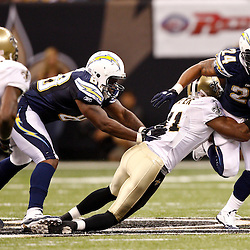 August 27, 2010; New Orleans, LA, USA; San Diego Chargers running back Ryan Mathews (24) is tackled by New Orleans Saints safety Roman Harper (41) during the first quarter of a preseason game at the Louisiana Superdome. Mandatory Credit: Derick E. Hingle