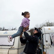 France, Calais. Refugee camp - the so-called Jungle. An Iraqi Kurdish father plays with his daughter.