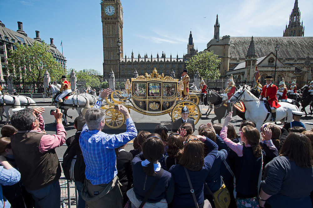 © Licensed to London News Pictures. 27/05/2015. London, UK. Queen Elizabeth II travels in a horse drawn carriage back  to Buckingham Palace in front of Elizabeth Clock Tower and the houses of parliament after attending State Opening of Parliament in London on May 27, 2015. Photo credit: Ben Cawthra/LNP