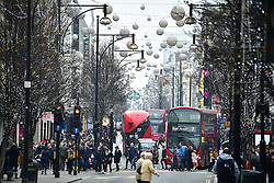 © Licensed to London News Pictures. 18/12/2016. London, UK. Seasonal shoppers take to the shops of Oxford Street in central London on December 18, 2016, on the last full weekend of shopping ahead of Christmas day. Photo credit: Ben Cawthra/LNP