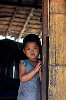 Young girl in a bamboo house,  Mae Sam Laep, Mae Hong Son Province, Thailand