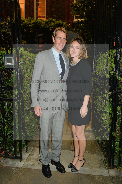 BEN & MARY-CLARE ELLIOT attending Annabel Goldsmith's Summer party held at her home in Ham, Surrey on 10th July 2014.