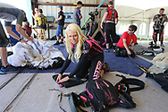 BRENDAN FITTERER  |  Times<br /> Jeannie Bartholomew with Team Alter Ego, and other competitors repack their chutes between practice jumps Friday for the upcoming United States Parachute Association National Championships of Canopy Piloting May 21-23 at Skydive City in Zephyrhills. In canopy piloting competition, also known as swooping, pilots navigate a competition course over a swoop pond and compete in speed, landing accuracy and distance.