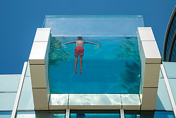 Glass walled swimming pool at InterContinental Hotel Festival City in Dubai United Arab Emirates
