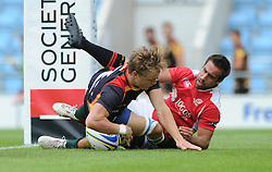 Tim Lightenberg of Germany scores a try as he is challenged by Diogo Miranda of Portugal - Photo mandatory by-line: Dougie Allward/JMP - Mobile: 07966 386802 - 11/07/2015 - SPORT - Rugby - Exeter - Sandy Park - European Grand Prix 7s
