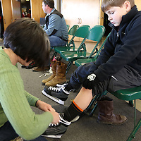 Libby Ezell | BUY AT PHOTOS.DJOURNAL.COM<br /> Karen Mayfield helps Stephen Gunnells, 9 lace up his ice skates Saturday