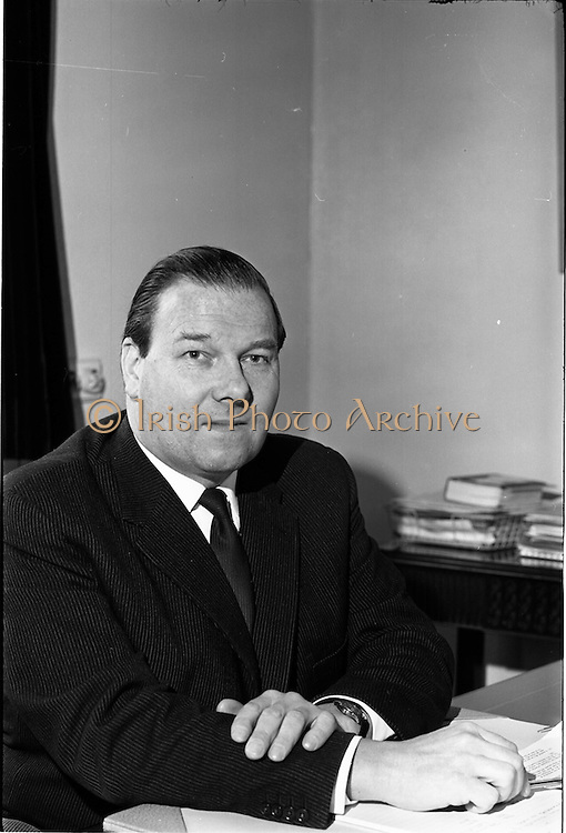 04/03/1964<br /> 03/04/1964<br /> 04 March 1964<br /> Smith Kline and French Laboratories personnel at Smith Kline and French Laboratories Ltd, Ashgrove, Dun Laoghaire Co. Dublin. Picture shows Mr. P. Greville, Goodbody Ltd., at his desk.