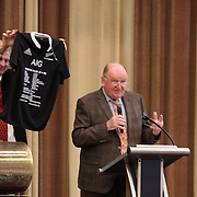 "Brian Vizard, Executive Director of the US Rugby Football Foundation, hold up Christian Cullen's jersey for auctioneer George Hook (right). NZ All Black former players Eric Rush, Frank Bunce, Charles Reichelmann, were honored guests among NZ and USA rugby fans at the pre-game ""Lost Afternoon Rugby Luncheon"" at the Chicago Hyatt Regency Hotel, Chicago, Illinois.  Photo by Barry Markowitz, 10/31/14, 2pm"