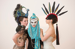The Animal Ball..This years Animal Ball which brings the glamour and splendour of a masked soiree to the heart of London will benefit the charity Elephant Family with masks created by the likes of Christian Lacroix, Mario Testino and Swarovski. Pic Shows Natalie Ellner wearing her creation 'Lady Peacock', Katherine Aplin wearing a creation by Johnny Rocket and Sunny Warrington with Swarovski and Lucy Franks wearing Mario Testino. The masks will be on show at Sotheby's until May 15th, London, UK, May 10, 2013. Photo by:  i-Images