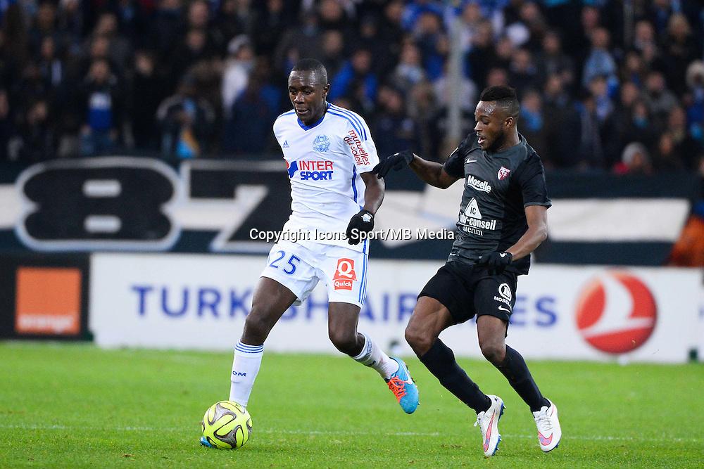 Giannelli IMBULA / Cheick DOUKOURE - 07.12.2014 - Marseille / Metz - 17eme journee de Ligue 1 -<br />Photo : Gaston Petrelli / Icon Sport