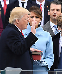 January 20, 2017 - Washington, DC, U.S. - President  DONALD J. TRUMP takes the Oath of Office from Chief Justice Roberts at his inauguration. Trump became the 45th President of the United States. (Credit Image: © Pat Benic/CNP via ZUMA Wire)