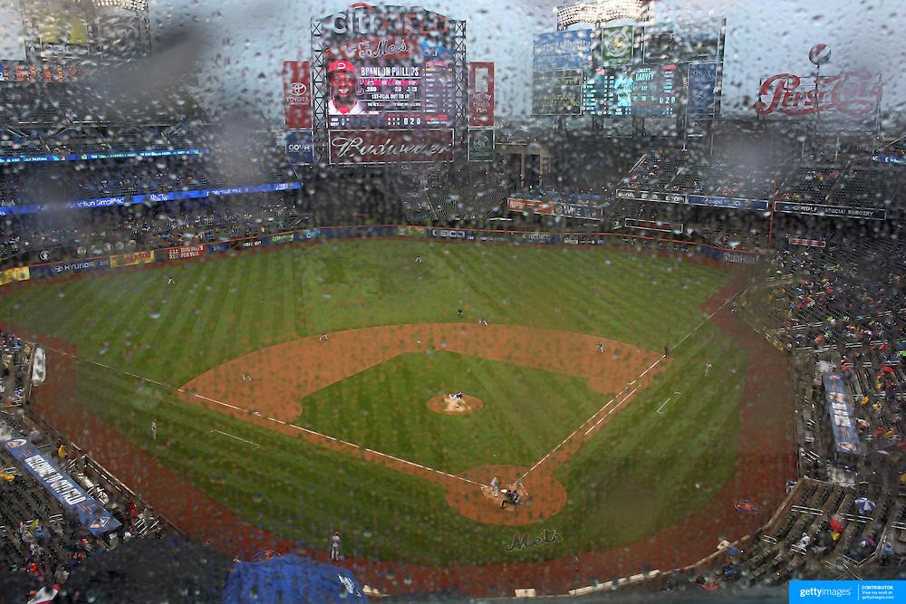 Pitcher Matt Harvey, New York Mets, pitching in the rain during the New York Mets Vs Cincinnati Reds MLB regular season baseball game at Citi Field, Queens, New York. USA. 27th June 2015. Photo Tim Clayton