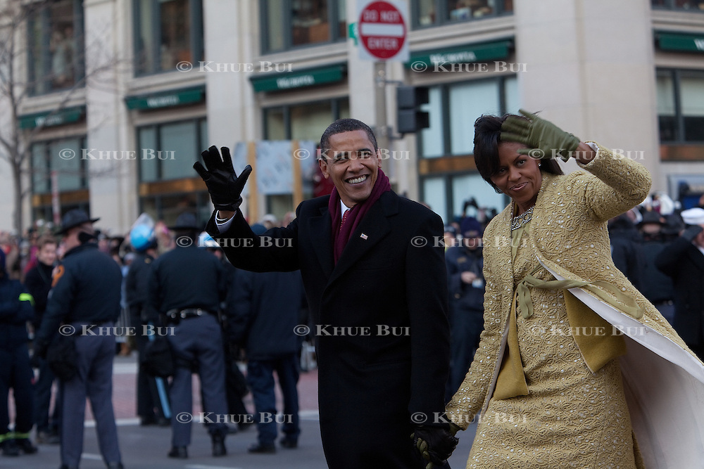 President Barack Obama and wife Michelle walk during the Inaugural parade Tuesday, January 20, 2009.  the parade followed his inauguration as the 44th President of the United States...Photo by Khue Bui