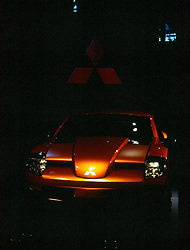 "Mitsubishi RPM 7000 Concept Car on display at the Chicago Auto Show, February 2001.  A formula one inspired exterior with retractable back glass, carbon fiber hood, third access door on passenger side, 19"" alloy wheels sporting 60 series tires, fold down rear seats, race car inspired interior with a roll cage, integrated door handles and rally style gauges buttons and switches...This image was electronically scanned from a 35mm transparency.  It may show spots, noise, scratches and other artifacts from that scan."