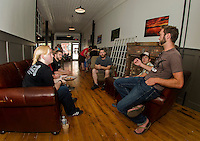 Bree Henderson Polished and Proper Barber Shop, Jared Champagne Laconia Village Bakery, Reuben Bassett Burrito Me, Myles Chase MC Cycle and Aaron Bassett Burrito Me sit down and discuss possibilities within the downtown Laconia Main Street at Wayfarer Coffee Roasters on Thursday afternoon.  (Karen Bobotas/for the Laconia Daily Sun)