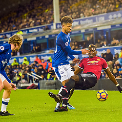 Mason Holgate of Everton and Paul Pogba of Manchester United challenge for a loose ball during the Premier League match between Everton and Manchester United, Goodison Park, Monday 1st January 2018<br /> (c) John Baguley | SportPix.org.uk