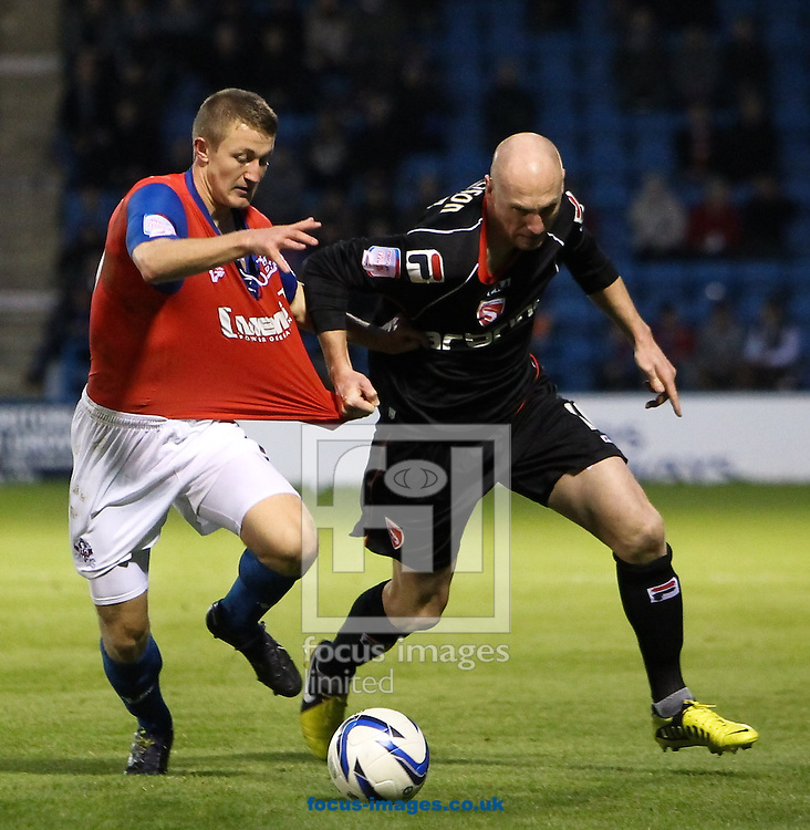 Picture by John  Rainford/Focus Images Ltd +44 7506 538356.17/11/2012.Callum Davies of Gillingham battles with Kevin Ellison of Morecambe during the npower League 2 match at the MEMS Priestfield Stadium, Gillingham.