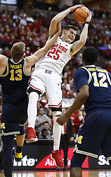 December 4, 2017 - Columbus, OH, USA - Ohio State Buckeyes forward Kyle Young (25) takes the rebound in front of Michigan Wolverines forward Moritz Wagner (13)  during the second half on Monday, Dec. 4, 2017, at Value Center Arena in Columbus, Ohio. (Credit Image: © Fred Squillante/TNS via ZUMA Wire)
