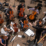 June 3, 2014 - New York, NY : Composer-conductor Matthias Pintscher, standing at bottom right, leads the New York Philharmonic as it rehearses a piece by an up-and-coming composer at Avery Fisher Hall on Tuesday. Works by three little-known composers (one each) will be selected for inclusion in the New York Philharmonic's Biennial. CREDIT: Karsten Moran for The New York Times