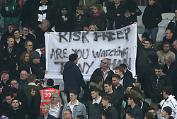 Fulham fans hold up a banner aimed at co-owner Tony Khan in the stands