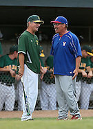West head coach Charlie Stumpff (from left) and Washington head coach Tony Lombardi talk between innings during their substate baseball game at Iowa City West High School in Iowa City on Friday evening, July 13, 2012. West defeated Washington 6-0.