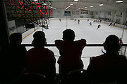 Injured or otherwise ineligible Fairport players watch their teammates scrimmage against Victor at Thomas Creek in Fairport on Monday, November 24, 2014.