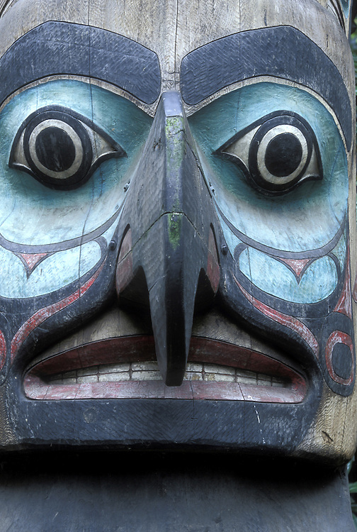 USA, Washington, Seattle, Totem pole located in Pioneer Square on rainy summer morning