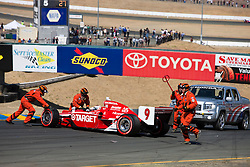 Scott Dixon (9) required assistance to restart after a first lap crash in turn 2 during the 2009 Sonoma Grand Prix IndyCar race was held at Infineon Raceway in Sonoma, California on August 23, 2009.