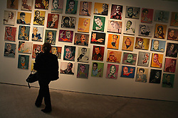 Marwan Sahmarani, a Lebanese artist, displays work in a gallery in the reconstructed area of downtown Beirut, Lebanon, March 15, 2006. The faces in the paintings are of the many political players throughout the civil war and in current Lebanese affairs.