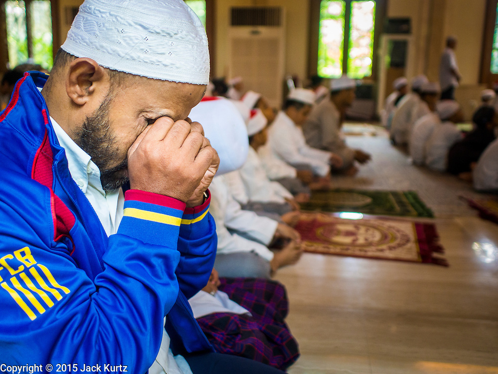 10 APRIL 2015 - BANGKOK, THAILAND: A man prays at Masjid Ton Son in Bangkok during Friday mid day prayers. (Masjid is the Thai word for Mosque.) A Pew Research Center study recently released identified Islam as the fastest growing religion in the world. Masjid Ton Son was the first mosque in Bangkok, founded in 1688 during the reign of King Narai, of the Ayutthaya era. Muslims are about 5 percent of Thailand, but make up a bigger proportion of Bangkok. Thailand's deep south provinces are Muslim majority.    PHOTO BY JACK KURTZ