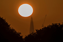 © Licensed to London News Pictures. 03/05/2018. London, UK. The sun rises over The Shard as the weather improves ahead of the bank holiday weekend. Photo credit: Peter Macdiarmid/LNP