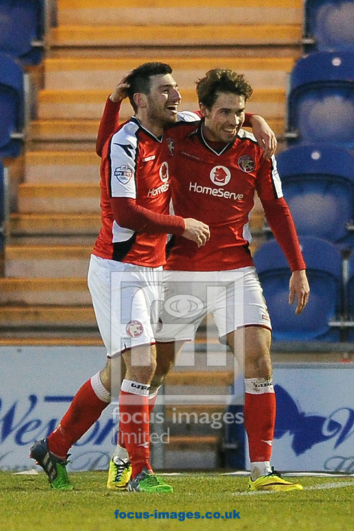 Michael Cain of Walsall (left) celebrates scoring his sides second goal to make the scoreline 2-0 during the Sky Bet League 1 match between Colchester United and Walsall at the Weston Homes Community Stadium, Colchester<br /> Picture by Richard Blaxall/Focus Images Ltd +44 7853 364624<br /> 17/01/2015