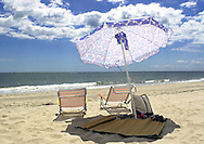 Unattended beach chairs, and an umbrella sit on the beach, Wednesday, August 7, 2002, in Cape May, New Jersey. (Photo by William Thomas Cain/photodx.com)