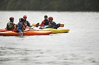 Group kayaking in river