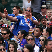 With Samoan music rocking the house Manu Samoa fans break out into a siva at the Hong Kong Sevens International Rugby Tournament, Hong Kong Stadium, Hong Kong.  Photo by Barry Markowitz, 3/25/12, Courtesy Tri Marine and Samoa Tuna Processors