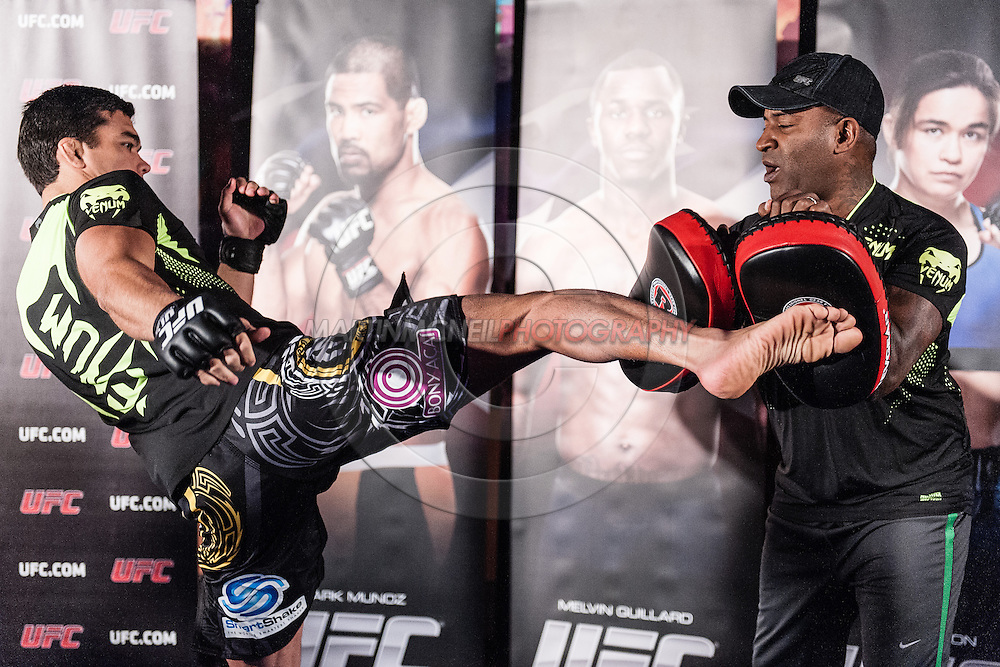 """MANCHESTER, ENGLAND, NOVEMBER 23, 2013: Lyoto Machida is pictured at the media open work-out sessions for """"UFC Fight Night 30: Machida vs. Munoz"""" inside Bierkeller Shooter's Sports Bar in The Printworks, Manchester (Martin McNeil for ESPN)"""