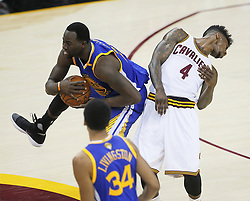 The Golden State Warriors' Draymond Green, top left, receives a technical foul for elbowing the Cleveland Cavaliers' Iman Shumpert (4) in the first quarter during Game 4 of the NBA Finals at Quicken Loans Arena in Cleveland on Friday, June 9, 2017. (Photo by Leah Klafczynski/Akron Beacon Journal/TNS) *** Please Use Credit from Credit Field ***