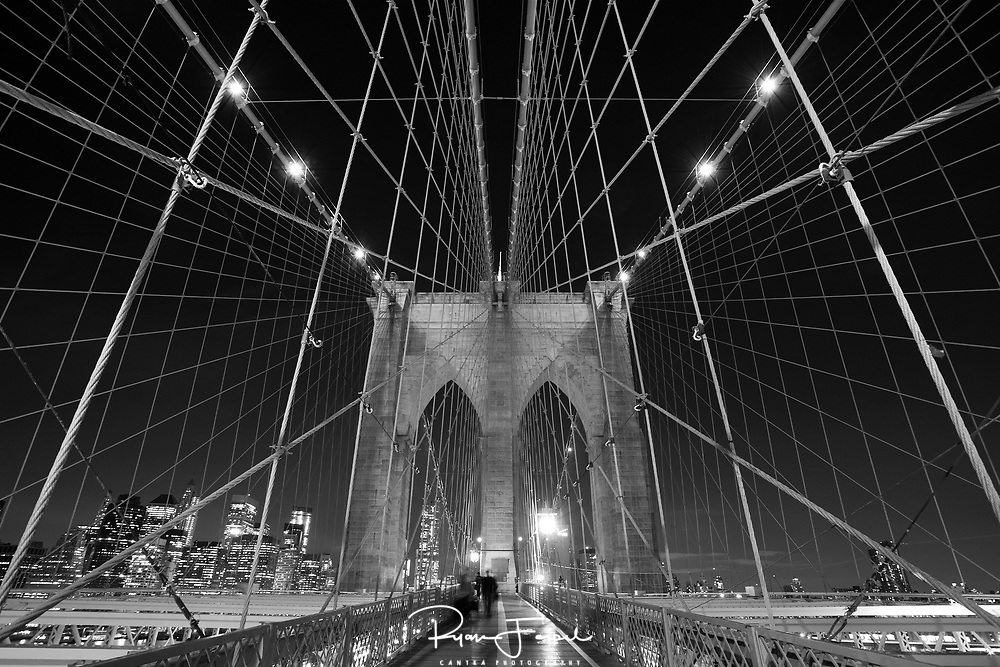 I spent a long day scouting different angles to shoot the Brooklyn Bridge but it wasn't until I started walking back to the city that I looked up and was in awe.  The age of the bridge adds to its character but doesn't help for long shutter speeds.  I could feel the vibration and sway in the walkway as cars sped by below.  Dodging runners and bikes, I set up the camera, pointed up and hoped for less traffic.