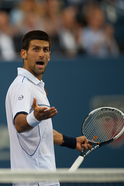 NEW YORK, NY - SEPTEMBER 12: Novak Djokovic of Serbia reacts after a point against Rafael Nadal of Spain during the Men's Final on Day Fifteen of the 2011 US Open at the USTA Billie Jean King National Tennis Center on September 12, 2011 in the Flushing neighborhood of the Queens borough of New York City. (Photo by Rob Tringali) *** Local Caption *** Novak Djokovic